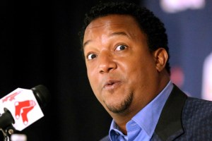 Former Boston Red Sox pitcher Pedro Martinez speaks Tuesday, Jan. 6, 2015, at Fenway Park, in Boston, after being elected to baseball's Hall of Fame. Martinez, a three-time Cy Young winner, helped the Red Sox to their first World Series title in 86 years in 2004. (AP Photo/Steven Senne)
